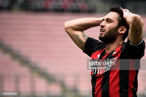 Hakan Calhanoglu of AC Milan looks dejected during the Serie A football match between AC Milan and Genoa CFC. AC Milan won 2-1 over Genoa CFC.