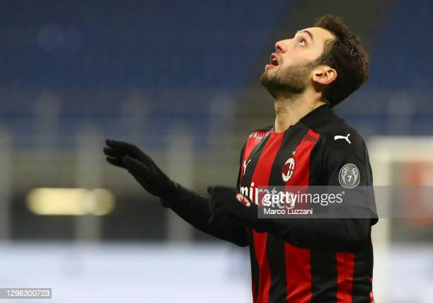 Hakan Calhanoglu of AC Milan looks on during the Coppa Italia match between AC Milan and Torino FC at Stadio Giuseppe Meazza on January 12, 2021 in...
