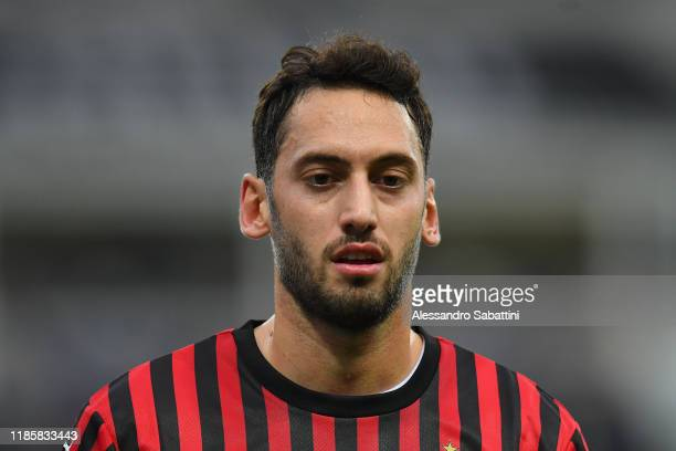 Hakan Calhanoglu of AC Milan looks on during the Serie A match between Parma Calcio and AC Milan at Stadio Ennio Tardini on December 1, 2019 in...