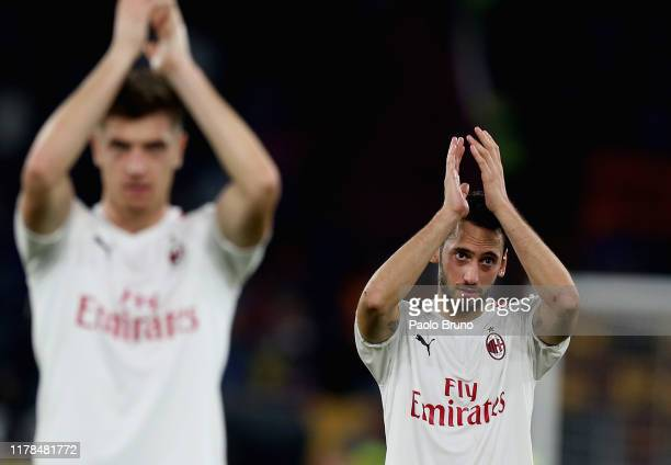 Hakan Calhanoglu of AC Milan reacts after the Serie A match between AS Roma and AC Milan at Stadio Olimpico on October 27 2019 in Rome Italy