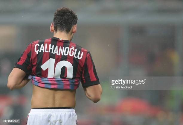 Hakan Calhanoglu of AC Milan reacts during the TIM Cup match between AC Milan and SS Lazio at Stadio Giuseppe Meazza on January 31 2018 in Milan Italy