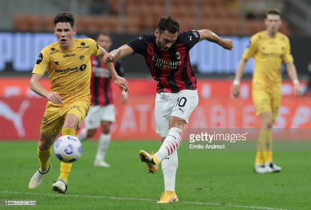 Hakan Calhanoglu of AC Milan scores a goal during the UEFA Europa League third qualifying round match between AC Milan and Bodo Glimt at Stadio...