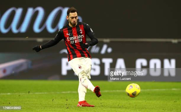 Hakan Calhanoglu of A.C. Milan scores his sides fifth penalty to win the penalty shoot out during the Coppa Italia match between AC Milan and Torino...