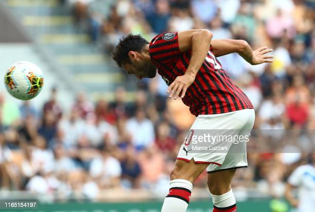 Hakan Calhanoglu of AC Milan scores the opening goal during the Serie A match between AC Milan and Brescia Calcio at Stadio Giuseppe Meazza on...