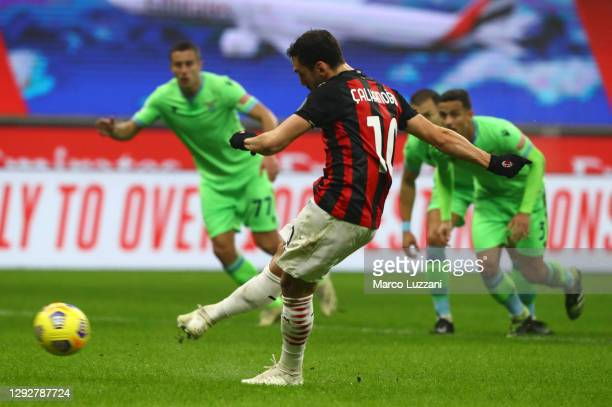 Hakan Calhanoglu of AC Milan scores their sides second goal from the penalty spot during the Serie A match between AC Milan and SS Lazio at Stadio...