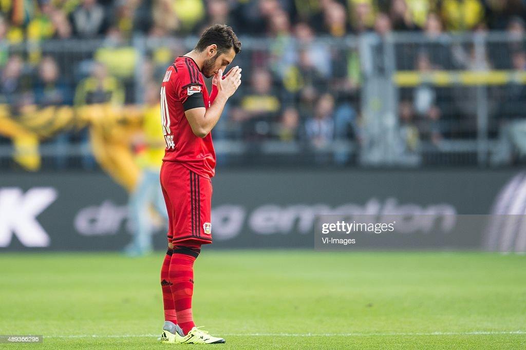 Hakan Calhanoglu of Bayer 04 Leverkusen is praying for the match ...