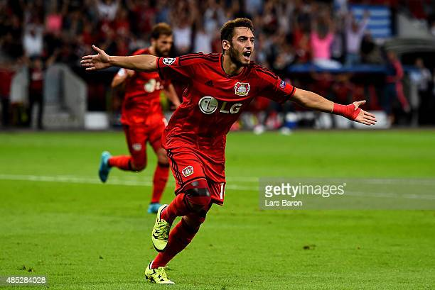 Hakan Calhanoglu of Bayer Leverkusen celebrates after scoring his teams first goal during the UEFA Champions League qualifying play off round 2nd leg...