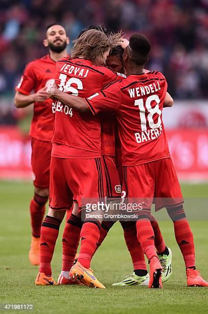 Hakan Calhanoglu of Bayer Leverkusen celebrates as he scores the opening goal during the Bundesliga match between Bayer 04 Leverkusen and FC Bayern...