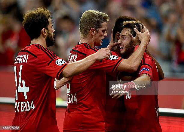 Hakan Calhanoglu of Bayer Leverkusen celebrates with team mates after scoring his teams first goal during the UEFA Champions League qualifying play...