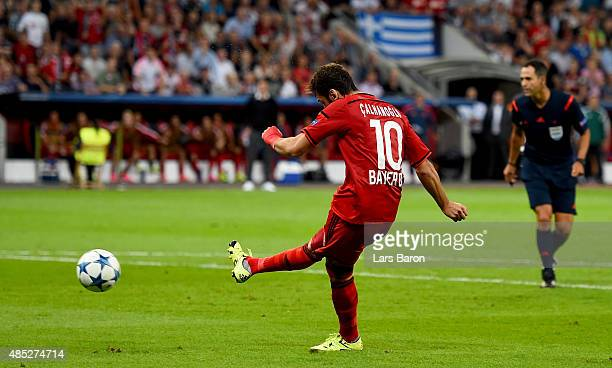 Hakan Calhanoglu of Bayer Leverkusen scores his teams first goal during the UEFA Champions League qualifying play off round 2nd leg between Bayer...
