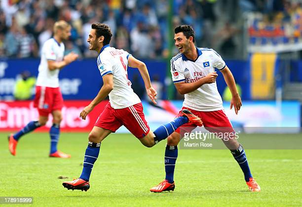 Hakan Calhanoglu of Hamburg celebrates after he scores his team's 3rd goal during the Bundesliga match between Hamburger SV and Eintracht...