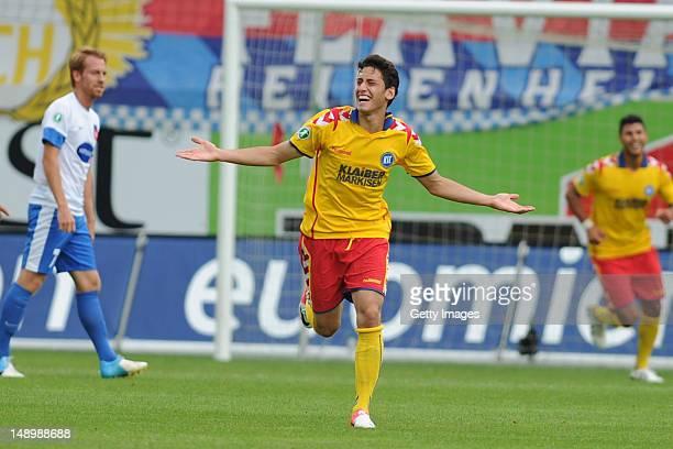 Hakan Calhanoglu of Karlsruhe celebrates his team's second goal during the Third League match between 1 FC Heidenheim v Karlsruher SC at VoithArena...