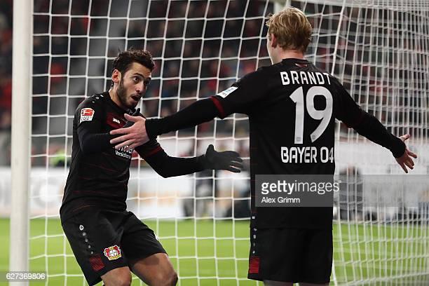 Hakan Calhanoglu of Leverkusen celebrates his team's first goal with team mate Julian Brandt during the Bundesliga match between Bayer 04 Leverkusen...