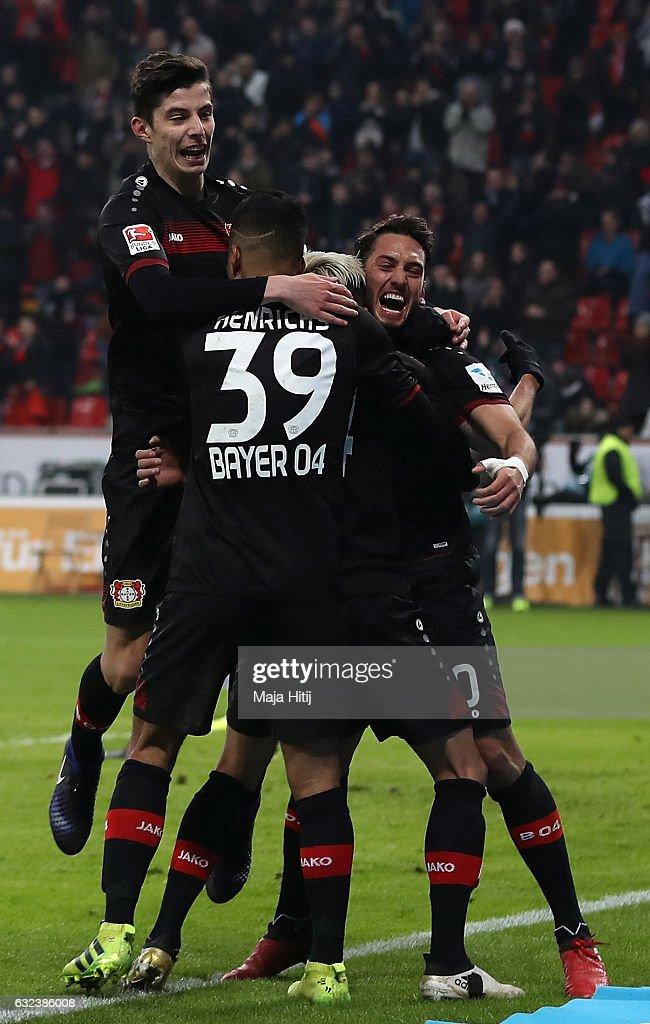 Hakan Calhanoglu of Leverkusen celebrates scoring the third goal with teamates during the Bundesliga match between Bayer 04 Leverkusen and Hertha BSC at BayArena on January 22, 2017 in Leverkusen, Germany.