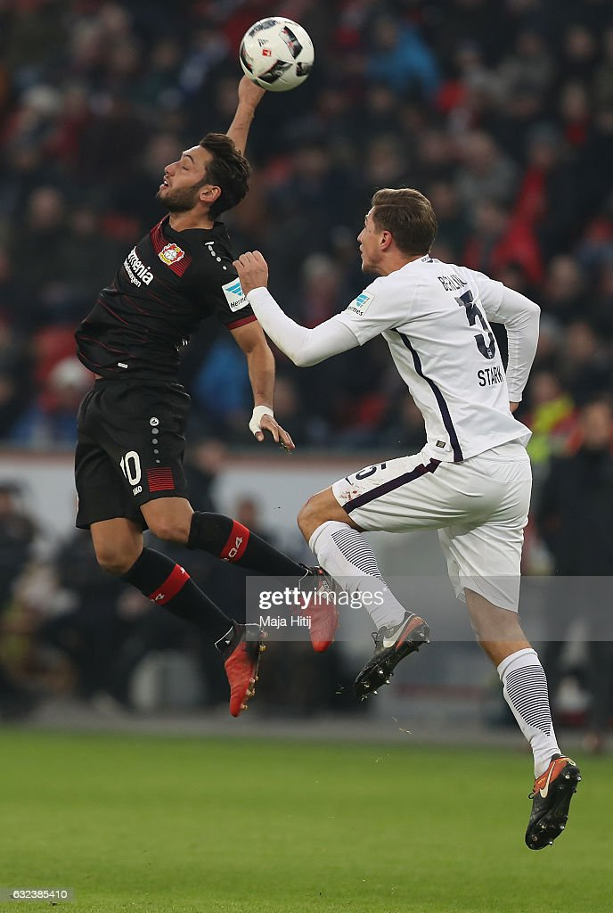 Hakan Calhanoglu of Leverkusen is challenged by Niklas Stark of Berlin during the Bundesliga match between Bayer 04 Leverkusen and Hertha BSC at BayArena on January 22, 2017 in Leverkusen, Germany.
