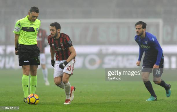 Hakan Calhanoglu of Milan player Massimiliano Irrati referee and Marco Parolo of Lazio player during the match valid for Italian Football...