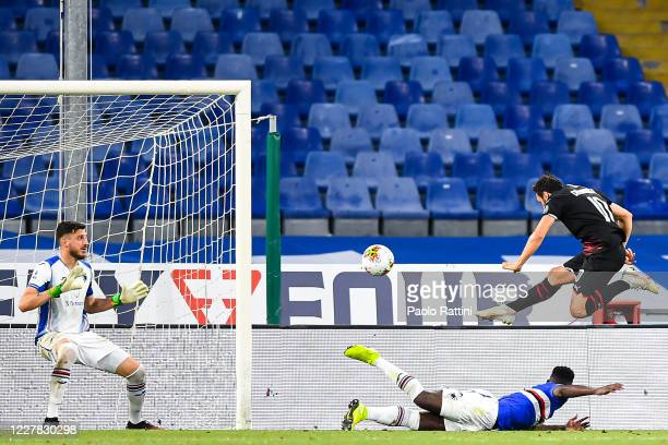 Hakan Calhanoglu of Milan scores a goal during the Serie A match between UC Sampdoria and AC Milan at Stadio Luigi Ferraris on July 29, 2020 in...