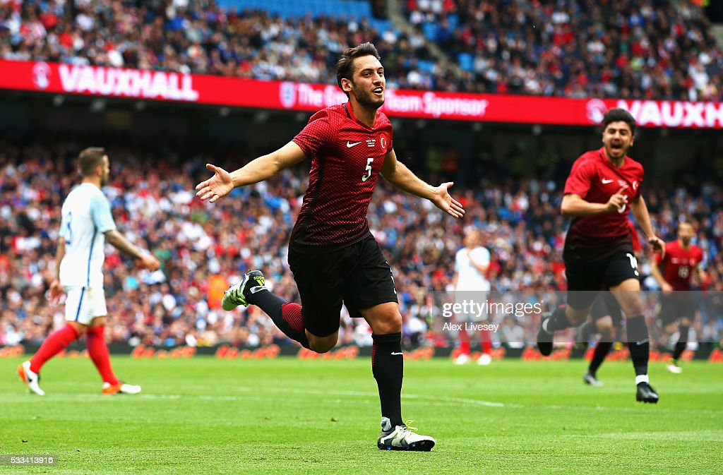 Hakan Calhanoglu of Turkey celebrates after scoring his team's first goal during the International Friendly match between England and Turkey at Etihad Stadium on May 22, 2016 in Manchester, England.