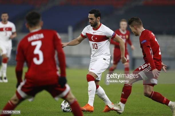 Hakan Calhanoglu of Turkey in action against David Miklos Siger of Hungary during the UEFA Nations League match between Hungary and Turkey at Puskas...