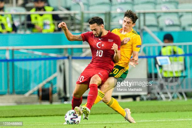 Hakan Calhanoglu of Turkey is challenged by Daniel James of Wales during the UEFA Euro 2020 Championship Group A match between Turkey and Wales on...