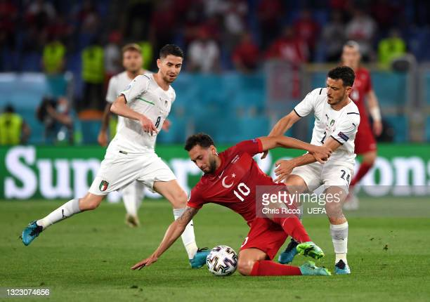 Hakan Calhanoglu of Turkey shields the ball from Jorginho and Alessandro Florenzi of Italy during the UEFA Euro 2020 Championship Group A match...