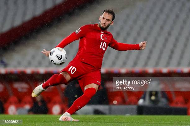 Hakan Calhanoglu of Turkey shoots to score Turkey's second goal during the World Cup Qualifier match between Turkey and Latvia at Ataturk Olympic...