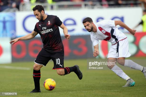 Hakan Calhanoglyu of Milan in contrast with Paolo Faragò during the Serie A match between Cagliari Calcio and AC Milan at Sardegna Arena on January...