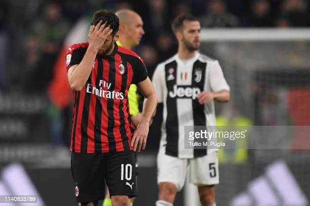 Hakan Cslhanoglu of Milan shows his dejection after losing the Serie A match between Juventus and AC Milan on April 06 2019 in Turin Italy