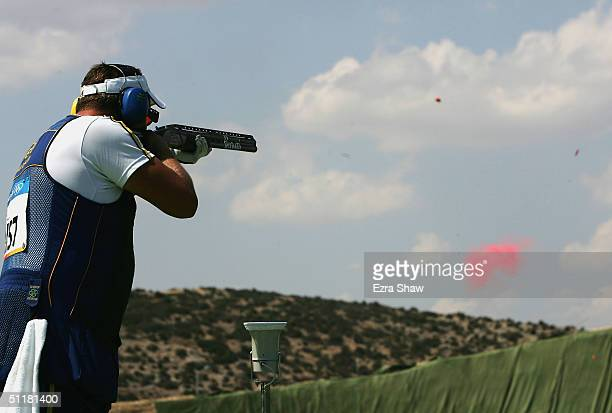 Hakan Dahlby of Sweden competes in the men's double trap event on August 17 2004 during the Athens 2004 Summer Olympic Games at the Markopoulo...