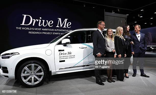 Hakan Samuelsson President and CEO Volvo Car Group stands with the Hain family from Sweden next to the autonomous Volvo vehicle they will be testing...