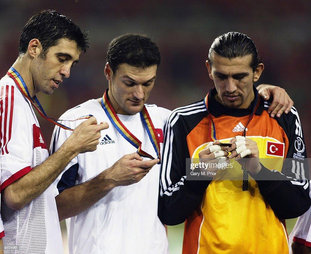 Hakan Sukur, Alpay Ozalan and Rustu Recber of Turkey with medals : News Photo