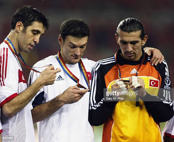 Hakan Sukur Alpay Ozalan and Rustu Recber of Turkey with medals after the South Korea v Turkey World Cup Third Place PlayOff match played at the...