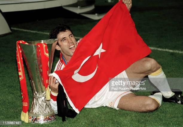 Hakan Sukur of Galatasaray celebrates with the trophy and a Turkish flag after the 2000 UEFA Cup Final between Galatasaray and Arsenal at the Parken...