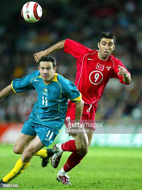 Hakan Sukur of Turkey, competes with Stan Lazaridis of Australia during the friendly international, at Aussie Stadium ,in Sydney, 21 May 2004....
