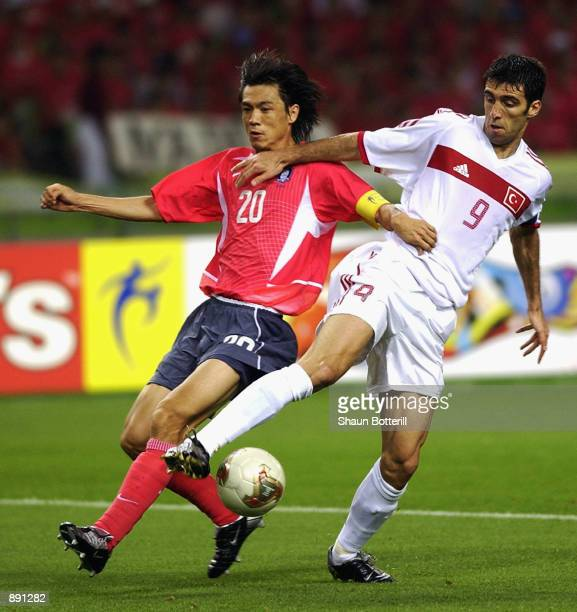 Hakan Sukur of Turkey reaches the ball ahead of Myung Bo Hong of South Korea during the FIFA World Cup Finals 2002 Third Place PlayOff match played...