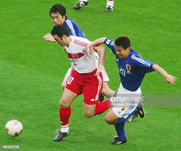 Hakan Unsal of Turkey and Tomokazu Myojin of Japan compete for the ball during the FIFA World Cup Korea/Japan round of 16 match between Japan and...