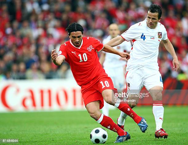Hakan Yakin of Switzerland and Tomas Galasek of Czech Republic battle for the ball during the UEFA EURO 2008 Group A match between Switzerland and...