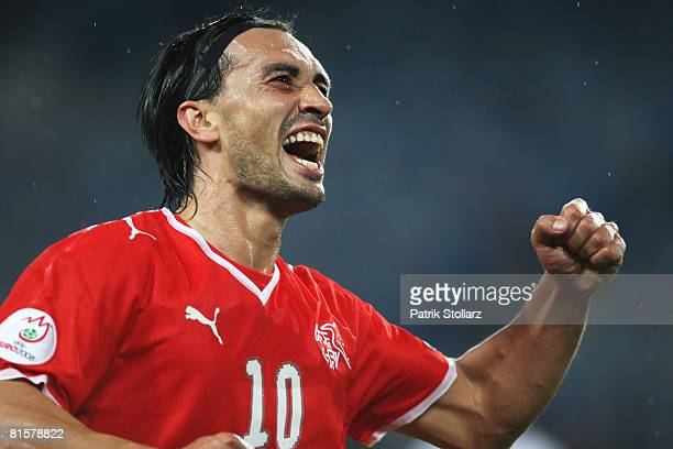Hakan Yakin of Switzerland celebrates the opening goal during the UEFA EURO 2008 Group A match between Switzerland and Portugal at St. Jakob-Park on...