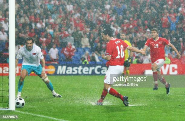 Hakan Yakin of Switzerland scores the opening goal during the UEFA EURO 2008 Group A match between Switzerland and Turkey at St JakobPark on June 11...