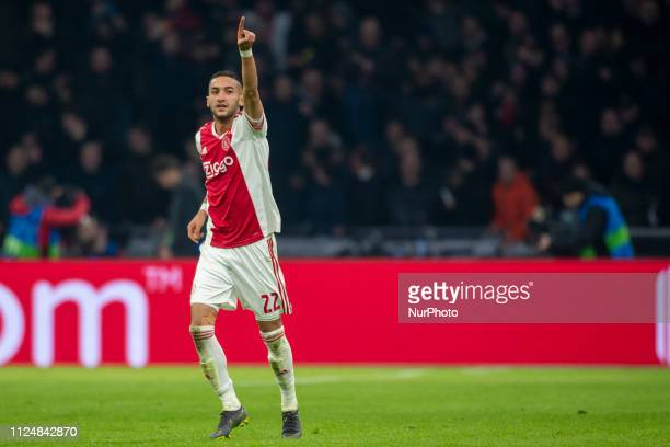 Hakan Ziyech of Ajax celebrates during the UEFA Champions League Round of 16 match between Ajax Amsterdam and Real Madrid at Johan Cruyff ArenA in...