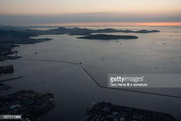 Hakata Bay and Fukuoka city in Japan sunset time aerial view from airplane
