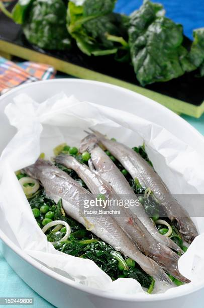 Hake and vegetables baked in foil