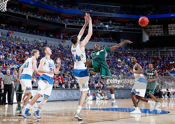 Hakeem Baxter of the UAB Blazers collides with Gyorgy Goloman of the UCLA Bruins during the third round of the 2015 NCAA Men's Basketball Tournament...