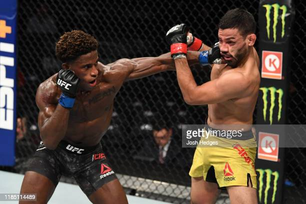 Hakeem Dawodu of Canada punches Julio Arce in their featherweight bout during the UFC 244 event at Madison Square Garden on November 02 2019 in New...