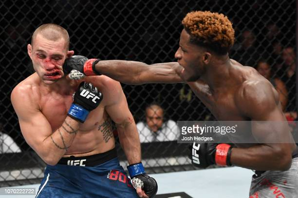 Hakeem Dawodu of Canada punches Kyle Bochniak in their featherweight fight during the UFC 231 event at Scotiabank Arena on December 8 2018 in Toronto...