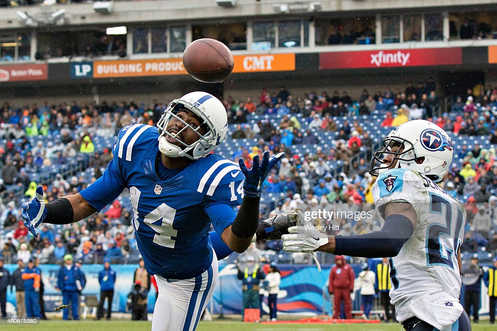 Hakeem Hicks #14 of the Indianapolis Colts misses a touchdown pass while being covered by Coty Sensabaugh #24 of the Tennessee Titans at LP Field on December 28, 2014 in Nashville, Tennessee. The Colts defeated the Titans 27-10.