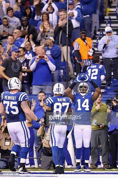Hakeem Nicks of the Indianapolis Colts celebrates after making a touchdown catch against the New England Patriots during the second quarter of the...