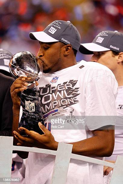 Hakeem Nicks of the New York Giants poses with the Vince Lombardi Trophy after the Giants defeated the Patriots by a score of 2117 in Super Bowl XLVI...