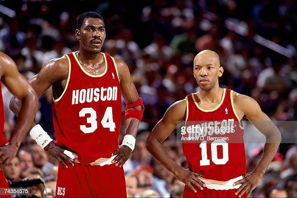 Hakeem Olajuwon and Sam Cassell of the Houston Rockets look on during Game Four of the NBA Finals played on June 15 1994 at Madison Square Garden in...