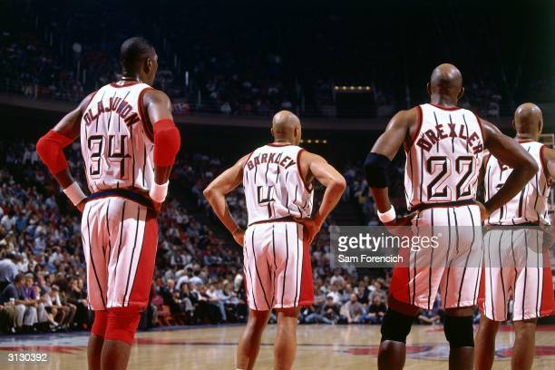 Hakeem Olajuwon Charles Barkley and Clyde Drexler of the Houston Rockets look on during a break in NBA game action circa 1997 in Houston Texas NOTE...
